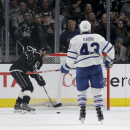 Los Angeles Kings right wing Marian Gaborik, left, scores a empty net goal as Toronto Maple Leafs center Nazem Kadri looks on during the third period of an NHL hockey game in Los Angeles, Monday, Jan. 12, 2015 The Associated Press
