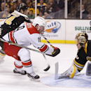 Carolina Hurricanes' Jiri Tlusty (19), of the Czech Republic, can not get the shot off against Boston Bruins goalie Tuukka Rask, of Finland, right, after a hooking penalty by Bruins' Adam McQuaid (54) during the first period of an NHL hockey game in Bosto