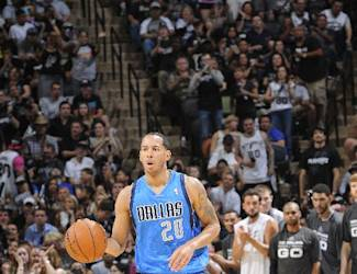 SAN ANTONIO, TX - MAY 4: Devin Harris #20 of the Dallas Mavericks dribbles up the court against the San Antonio Spurs in Game Seven of the Western Conference Quarterfinals during the 2014 NBA Playoffs on MAY 4, 2014 at the AT&T Center in San Antonio, Texas