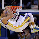 OAKLAND, CA - JANUARY 25: Stephen Curry #30 of the Golden State Warriors hangs on the rim after dunking the ball on Gerald Wallace #45 of the Boston Celtics at ORACLE Arena on January 25, 2015 in Oakland, California. (Photo by Ezra Shaw/Getty Images)