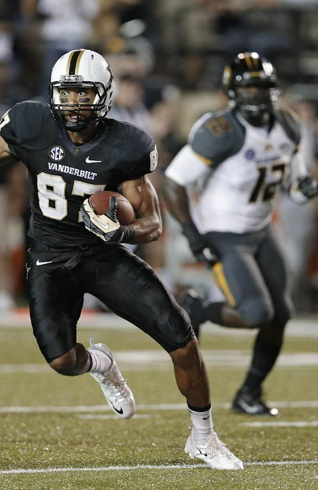 Vanderbilt wide receiver Jordan Matthews (87) is chased by Missouri defenders Ian Simon (21), Darvin Ruise (12) and Randy Ponder (7) while gaining 35 yards on a pass play in the third quarter of an NCAA college football game on Saturday, Oct. 5, 2013, in Nashville, Tenn