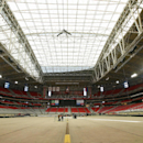 The roof remained closed at University of Phoenix Stadium, where the NFL football's Super Bowl XLIX will be played, while the grass field remained outside in the sun, Tuesday, Jan. 20, 2015, in Glendale, Ariz. At this point, the NFL says it plans to kee