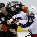 Anaheim Ducks defenseman Clayton Stoner, left, and Columbus Blue Jackets right wing Jared Boll fight during the third period of an NHL hockey game in Anaheim, Calif., Friday, Oct. 24, 2014. The Ducks won 4-1 The Associated Press