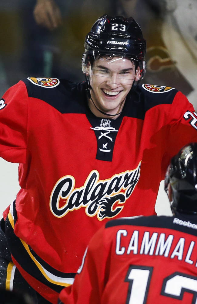 Oilers rally past Flames 4-2