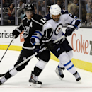 Los Angeles Kings center Anze Kopitar (11) and Winnipeg Jets defenseman Dustin Byfuglien (33) battle for the puck during the third period of an NHL hockey game at the Staples Center Saturday, March 29, 2014, in Los Angeles The Associated Press
