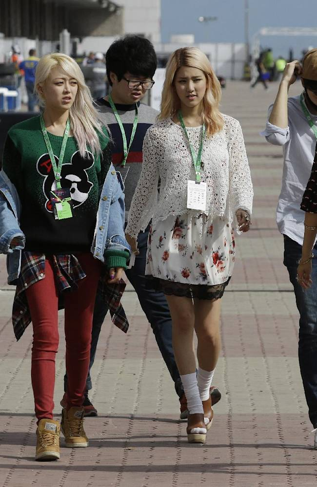 Korean K-pop girl band SPICA walk down the F1 paddock following the qualifying session for the Korean Formula One Grand Prix at the Korean International Circuit in Yeongam, South Korea, Saturday, Oct. 5, 2013