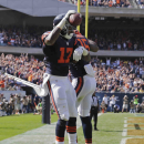 Chicago Bears wide receiver Alshon Jeffery (17) celebrates with wide receiver Brandon Marshall (15) after a touchdown reception in the first half of an NFL football game against the Green Bay Packers Sunday, Sept. 28, 2014, in Chicago. The Associated Pres