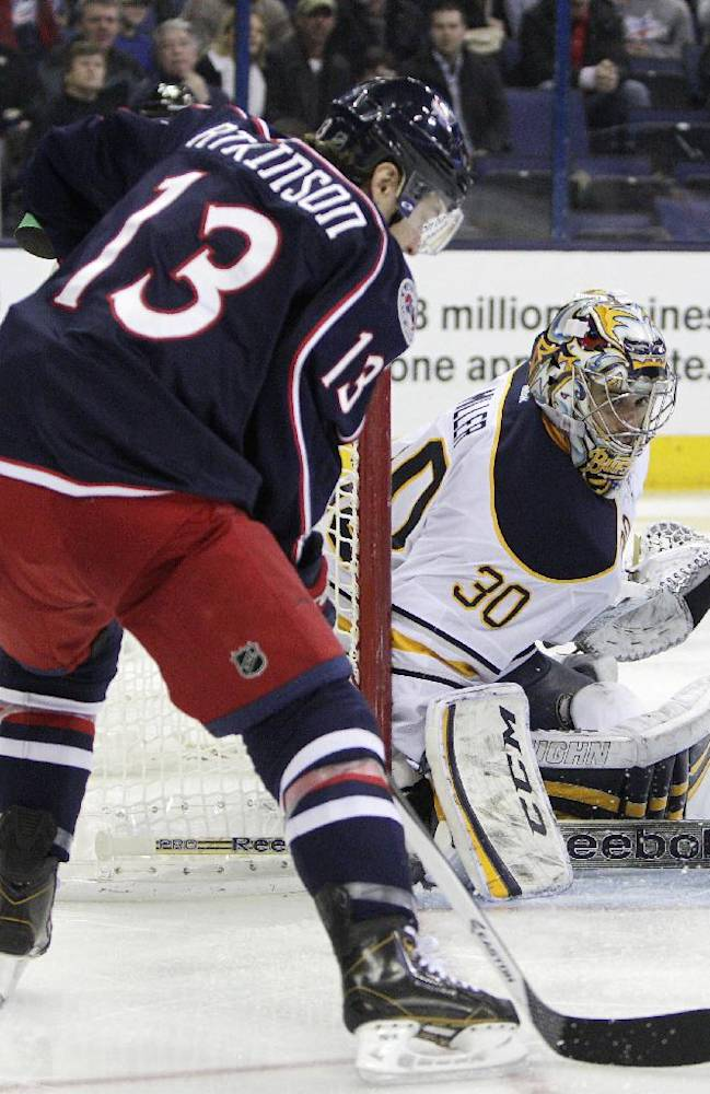 Buffalo Sabres' Ryan Miller, right, makes a save against Columbus Blue Jackets' Cam Atkinson during the second period of an NHL hockey game, Saturday, Jan. 25, 2014, in Columbus, Ohio. The Sabres won 5-2