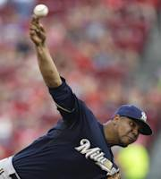 Milwaukee Brewers starting pitcher Wily Peralta throws against the Cincinnati Reds in the first inning of a baseball game, Saturday, Aug. 24, 2013, in Cincinnati. (AP Photo/Al Behrman)