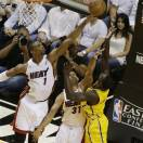 Miami Heat center Chris Bosh (1) blocks a shot to the basket by Indiana Pacers guard Lance Stephenson (1) as Heat forward Shane Battier (31) defends during the first half of Game 2 in their NBA basketball Eastern Conference finals playoff series, Friday, May 24, 2013, in Miami. (AP Photo/Alan Diaz)