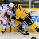 New York Rangers defenseman Ryan McDonagh (27) and Nashville Predators forward Matt Hendricks (26) try to control the puck in the first period of an NHL hockey game on Saturday, Nov. 23, 2013, in Nashville, Tenn The Associated Press