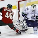 Vancouver Canucks goalie Eddie Lack (31) deflects a shot by Minnesota Wild defenseman Jared Spurgeon (46) during the first period of an NHL hockey game in St. Paul, Minn., Wednesday, March 26, 2014 The Associated Press