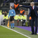 Arsenal's manager Arsene Wenger points to members of his team after they scored the equalising goal during the Group D Champions League match between Anderlecht and Arsenal at Constant Vanden Stock Stadium in Brussels, Belgium, Wednesday Oct. 22, 2014. Ar