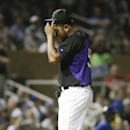 Colorado Rockies starting pitcher Franklin Morales wirpes his face during the second inning of a spring exhibition baseball game against the Chicago Cubs in Scottsdale, Ariz., Wednesday, March 19, 2014 The Associated Press