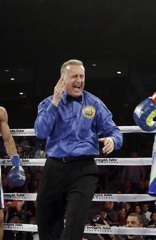 Referee Jack Reiss yells at Edwin Rodriquez, of the Dominican Republic, right, and Andre Ward, causing him to take two points away from each boxer for fighting on the break, in the fourth round of their super middleweight championship boxing match in Ontario, Calif., Saturday, Nov. 16, 2013. Ward won by unanimous decision