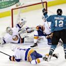 San Jose Sharks' Patrick Marleau (12) scores past New York Islanders goalie Kevin Poulin (60) during the second period of an NHL hockey game on Tuesday, Dec. 10, 2013, in San Jose, Calif. (AP Photo/Marcio Jose Sanchez)