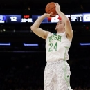Notre Dame's Pat Connaughton (24) shoots a 3-pointer during the first half of an NCAA college basketball game against the Rutgers at the Big East Conference tournament, Wednesday, March 13, 2013, in New York. (AP Photo/Frank Franklin II)