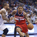 Washington Wizards guard Bradley Beal (3) drives around Orlando Magic guard Jameer Nelson during the first half of an NBA basketball game in Orlando, Fla., Friday, Apr. 11, 2014 The Associated Press