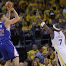 Los Angeles Clippers' Blake Griffin (32) shoots over Golden State Warriors' Jermaine O'Neal (7) during the second half in Game 3 of an opening-round NBA basketball playoff series on Thursday, April 24, 2014, in Oakland, Calif. Los Angeles won 98-96 The As