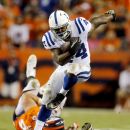 Indianapolis Colts running back Ahmad Bradshaw runs against the Denver Broncos during the second half of an NFL football game, Sunday, Sept. 7, 2014, in Denver The Associated Press