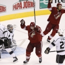 Arizona Coyotes' Shane Doan (19) and Antoine Vermette, top right, celebrate the game-winning goal by teammate Oliver Ekman-Larsson as Los Angeles Kings' Jarret Stoll (28), Matt Greene (2) and goalie Jonathan Quick look in a variety of directions looking f
