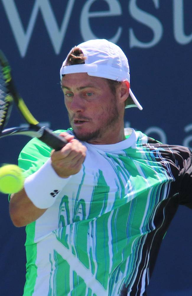 Lleyton Hewitt, of Australia, returns a volley to Fabio Fognini, of Italy, at the Western & Southern Open tennis tournament, Wednesday Aug. 13, 2014, in Mason, Ohio
