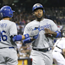 Los Angeles Dodgers' Hanley Ramirez is congratulated by Dodgers' Andre Ethier after scoring against the San Diego Padres in the first inning of an MLB National League baseball game Wednesday, April 2, 2014, in San Diego The Associated Press