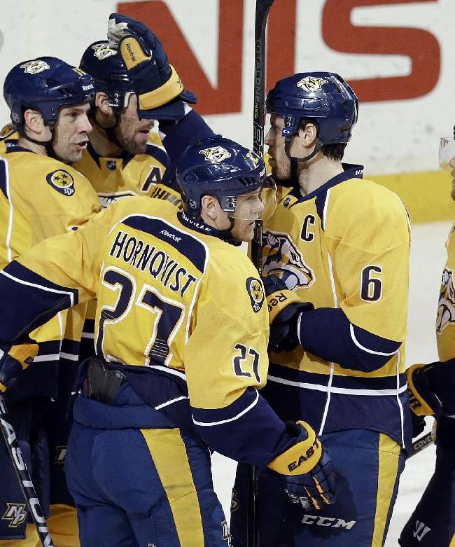 Nashville Predators forward Patric Hornqvist (27), of Sweden, celebrates with David Legwand (11), Shea Weber (6) and Ryan Ellis (4) after Hornqvist scored against the Colorado Avalanche in the second period of an NHL hockey game Saturday, Jan. 18, 2014, in Nashville, Tenn