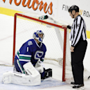 Vancouver Canucks goaltender Roberto Luongo talks to a linesmen after being knocked down during a play against the Phoenix Coyotes during third period NHL hockey action in Vancouver, British Columbia, on Friday Dec. 6, 2013 The Associated Press