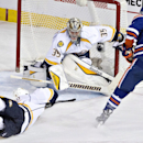 Nashville Predators' Ryan Ellis (4) sweeps the puck away from Edmonton Oilers' Teddy Purcell (16) as goalie Pekka Rinne (35) looks for the puck during the second period of an NHL hockey game, Wednesday, Oct. 29, 2014 in Edmonton, Alberta The Associated Pr