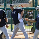 New York Yankees' Jacoby Ellsbury, left, Brian McCann, center, and Carlos Beltran stretch before an exhibition spring training baseball game against the Detroit Tigers in Lakeland, Fla., Friday, Feb. 28, 2014 The Associated Press
