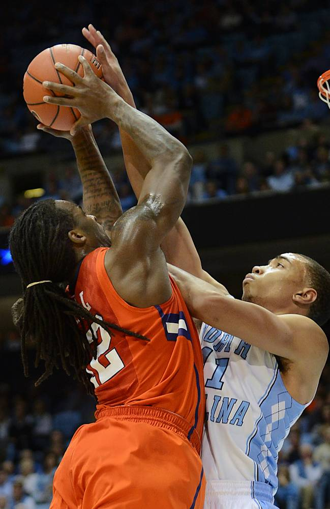 North Carolina's Brice Johnson blocks the shot of Clemson's Rod Hall, left, during an NCAA college basketball game on Sunday, Jan. 26, 2014, in Chapel Hill, N.C