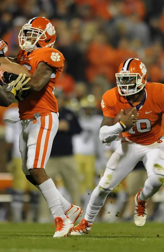 Clemson quarterback Tajh Boyd scrambles out of the pocket during the first half of an NCAA college football game against Georgia Tech Thursday, Nov. 14, 2013, at Memorial Stadium in Clemson, S.C.Clemson won 55-31