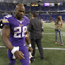 FILE - In ths Oct. 7, 2013, file photo, Minnesota Vikings running back Adrian Peterson (28) walks off the field after an NFL football game against the Green Bay Packers in Minneapolis. After enduring the fallout from child abuse allegations against star running back Adrian Peterson, the Vikings first-year coach Mike Zimmer might benefit from visiting an old friend in the football business. He'll do so this Sunday when he sees Saints coach Sean Payton in the New Orleans, though the timing is far from ideal. (AP Photo/Ann Heisenfelt, File)