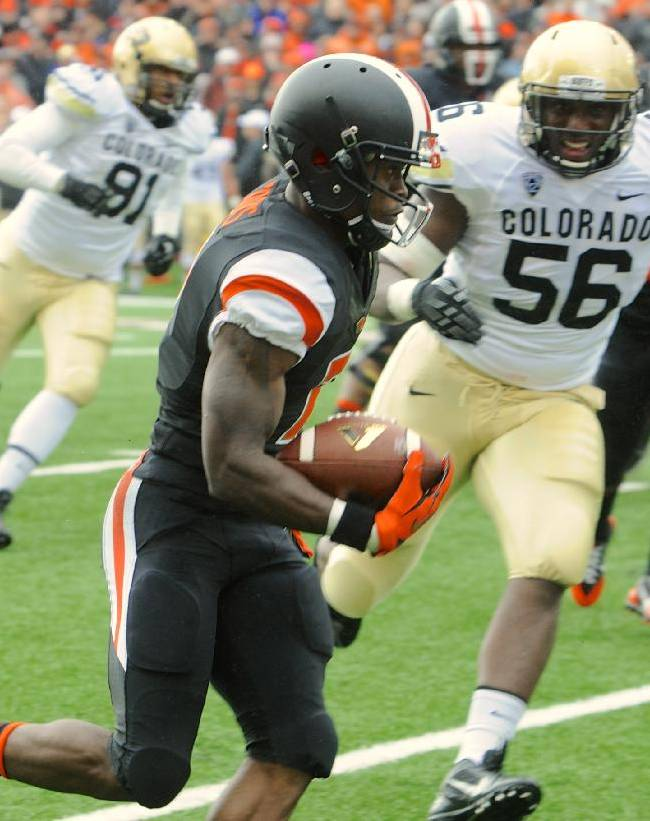 Oregon State's Brandin Cooks (7) runs against Colorado's Juda Parker (56) in the first half of an NCAA college football game on Saturday, Sept 28, 2013,  in Corvallis, Ore