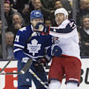 Columbus Blue Jackets Dalton Prout, right, tangles with Toronto Maple Leafs James van Riemsdyk during the third period of an NHL hockey game in Toronto on Monday, March 3, 2014 The Associated Press
