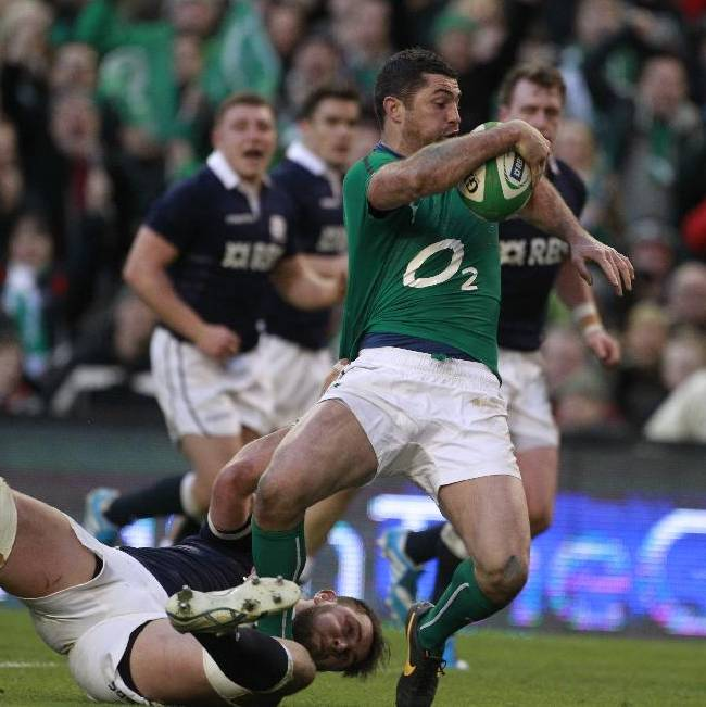 Ireland's Rob Kearney, right, breaks throuh to score a try despite being tackled by Scotland's Ryan Wilson during their Six Nations Rugby Union international match at the Aviva Stadium, Dublin, Ireland, Sunday, Feb. 2, 2014