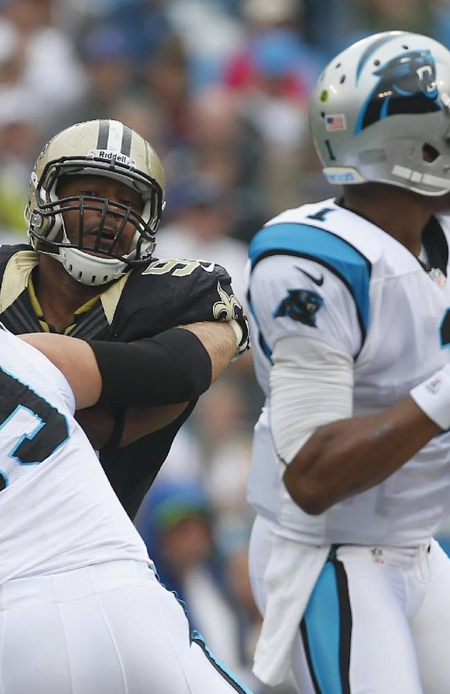 In this Sept. 16, 2012 file photo, Carolina Panthers left tackle Jordan Gross (69) keeps New Orleans Saints' Will Smith (91) blocked as Panthers quarterback Cam Newton (1) looks for a receiver during the first half of an NFL game in Charlotte, N.C. The Panthers will have to find someone new to protect Newton's blindside following the retirement of  Gross