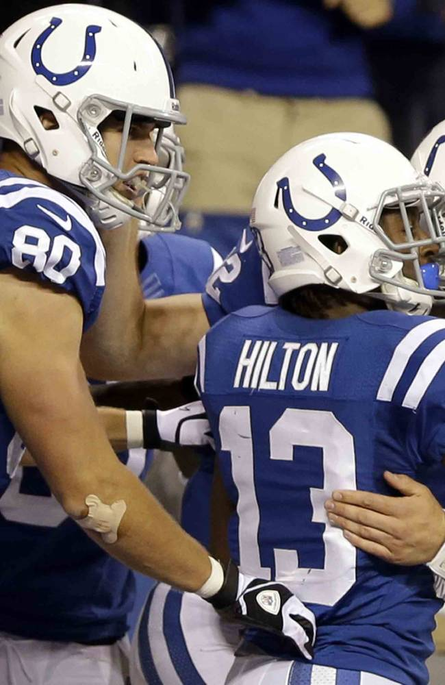 In this Oct. 20, 2013 file photo, Indianapolis Colts quarterback Andrew Luck celebrates his touchdown with tight end Coby Fleener (80) and wide receiver T.Y. Hilton (13) during the second half of an NFL football game against the Denver Broncos, in Indianapolis. Last season, the Colts overcame the loss of Peyton Manning and the loss of their coach as he battled cancer to make the playoffs. This season, Andrew Luck has already guided Indy to three fourth-quarter wins and the Colts are a remarkable 13-2 in one-possession games over the last two seasons
