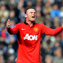 Manchester United's Wayne Rooney shouts instructions to team mates during the English Premier League soccer match between West Bromwich Albion and Manchester United at The Hawthorns Stadium in West Bromwich, England, Saturday, March 8, 2014