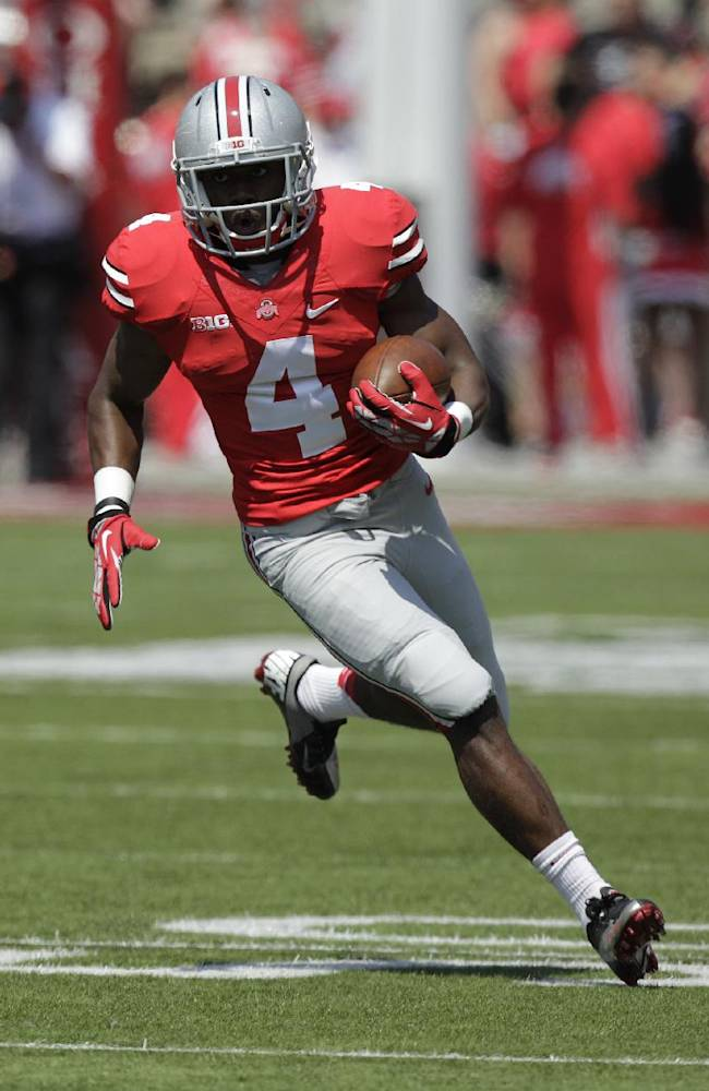 In this April 12, 2014, file photo, Ohio State running back Curtis Samuel carries the ball during the spring NCAA college football game in Columbus, Ohio. The flashy freshman joins the backfield with Ezekiel Elliott and Rod Smith