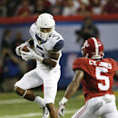 West Virginia wide receiver Mario Alford (5) makes a catch as Alabama defensive back Cyrus Jones (5) defends during the first half of an NCAA college football game Saturday, Aug. 30, 2014, in Atlanta The Associated Press