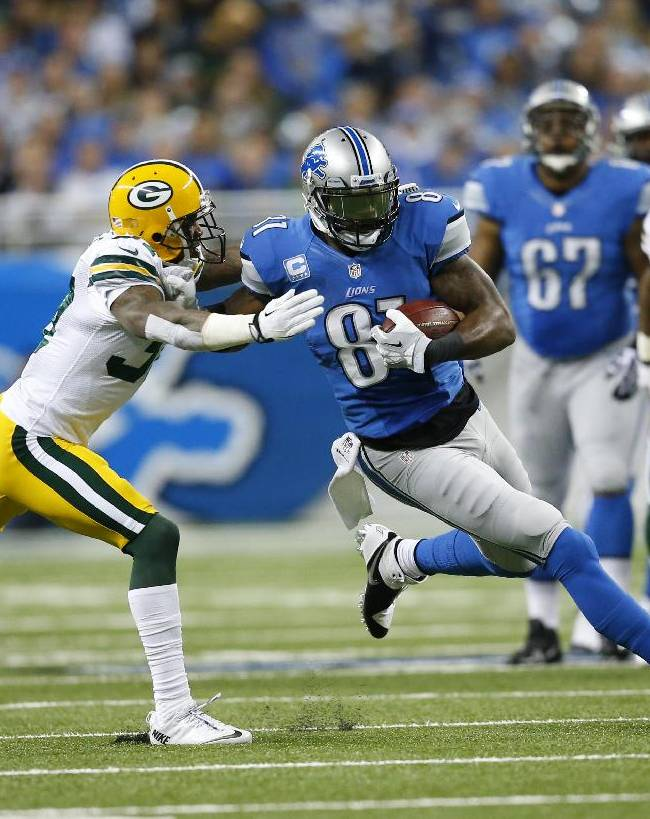 In this Nov. 28, 2013, file photo, Detroit Lions wide receiver Calvin Johnson (81) is defended by Green Bay Packers cornerback Sam Shields during an NFL football game in Detroit. Signing a four-year, $39 million deal with a $12.5 million signing bonus can be a life-changing event, especially for the fifth-year undrafted cornerback Shields who didn't move to defense until his last year in college