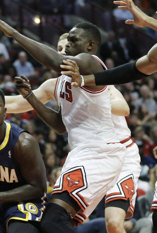 Indiana Pacers guard Lance Stephenson (1), left, looks to pass as Chicago Bulls' Luol Deng (9), Erik Murphy (31) and Taj Gibson (22) guard during the second half of an NBA preseason basketball game in Chicago on Friday, Oct. 18, 2013. The Bulls won 103-98