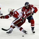 Detroit Red Wings defenseman Jakub Kindl (4), from the Czech Republic, defends as Washington Capitals center Jay Beagle (83) tries to shoot the puck, in the third period of an NHL hockey game, Wednesday, Oct. 29, 2014, in Washington. The Red Wings won 4-2