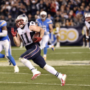 New England Patriots wide receiver Julian Edelman runs for a touchdown against the San Diego Chargers during the second half in an NFL football game Sunday, Dec. 7, 2014, in San Diego The Associated Press