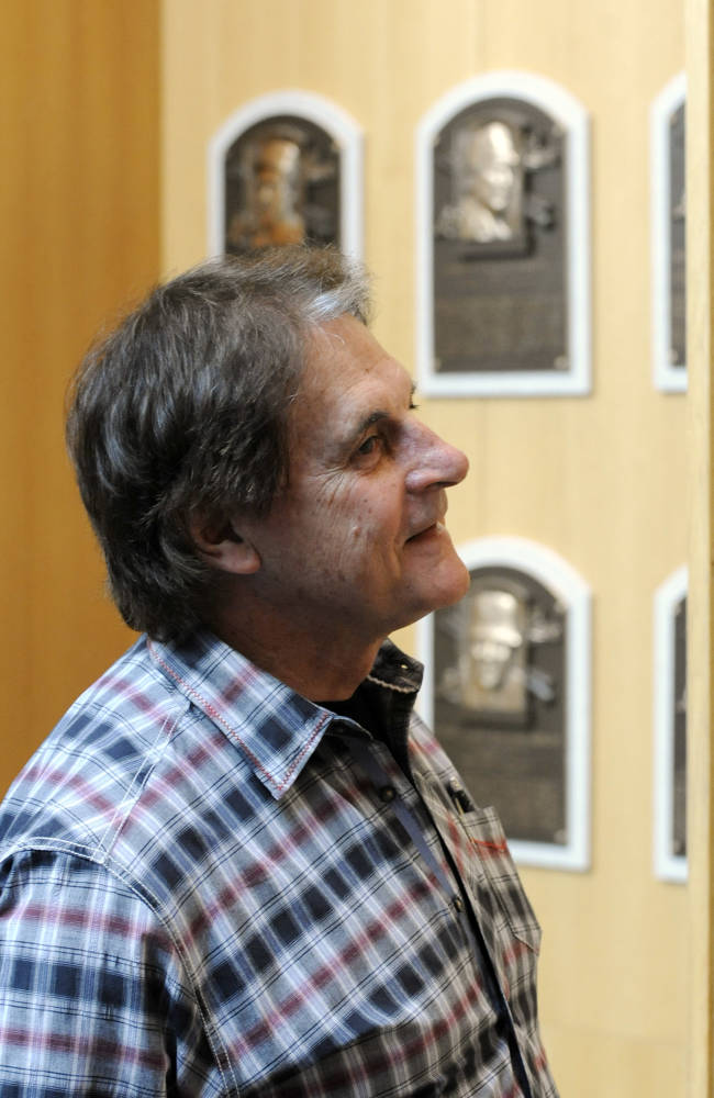 Baseball Hall of Fame inductee Tony La Russa views plaques at the National Baseball Hall of Fame and Museum in Cooperstown, N.Y., Thursday, April 10, 2014. La Russa is scheduled to be inducted into the hall this summer