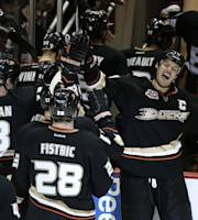 Anaheim Ducks' Ryan Getzlaf, right, celebrates his game-winning goal against the Tampa Bay Lightning after an NHL hockey game on Friday, Nov. 22, 2013, in Anaheim, Calif. The Ducks won 1-0 in overtime. (AP Photo/Jae C. Hong)
