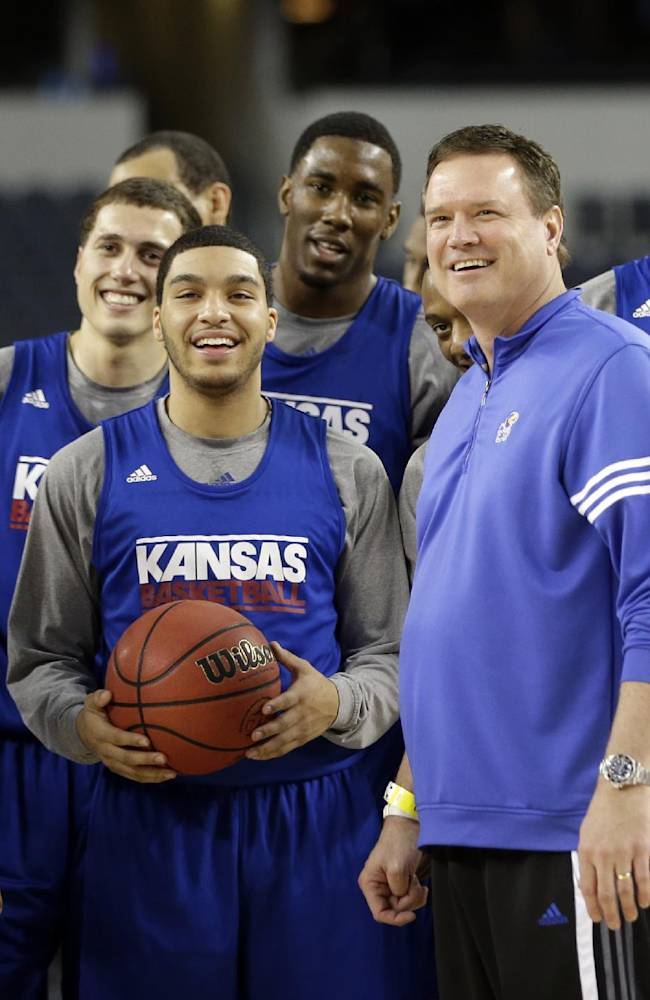 Kansas head coach Bill Self smiles with his players during practice for a regional semifinal game in the NCAA college basketball tournament, Thursday, March 28, 2013, in Arlington, Texas. Kansas faces Michigan on Friday