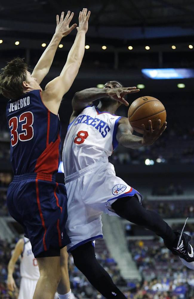 Philadelphia 76ers guard Tony Wroten (8) goes to the basket against Detroit Pistons forward Jonas Jerebko (33), of Sweden, during the first half of an NBA basketball game on Sunday, Dec. 1, 2013, in Auburn Hills, Mich